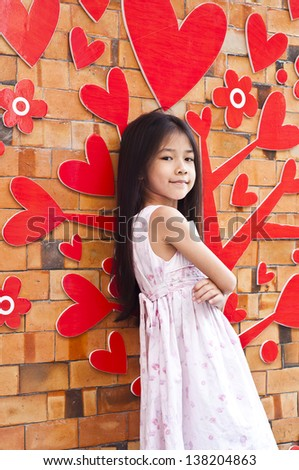 Little Asian girl posing.