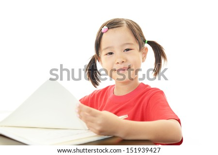 Little Asian girl studying