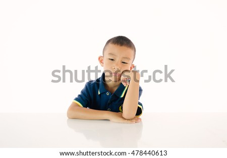 Little asian (thai) boy thinking and boring  on white background