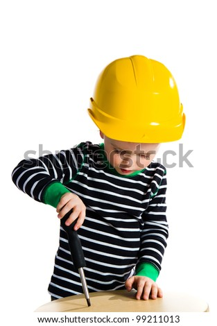 Little baby boy playing with screwdriver - isolated on white background