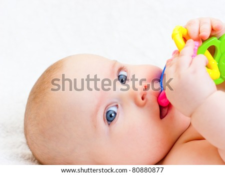 Little baby girl playing with teething toy