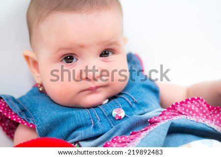 Little baby girl with a blue and pink dress