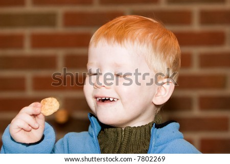 Little boy about to eat a potato chip