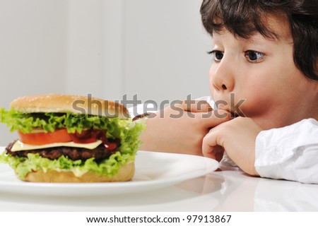 Little boy and burger