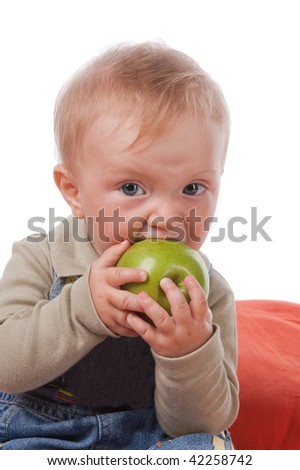 little boy and green apple on white background.  isolated.