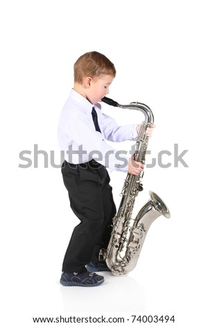 little boy and the big saxophone. It is isolated.