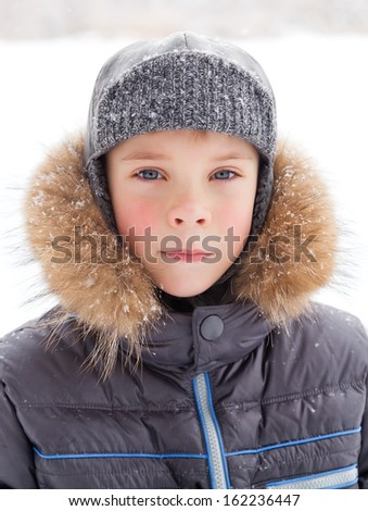 Little boy at wintertime with warm coat