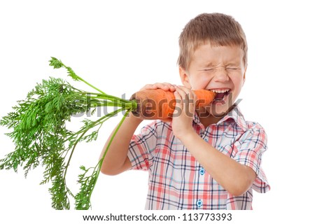 Little boy biting the carrot, isolated on white
