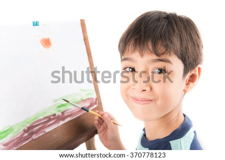 Little boy drawing and painting picture art  in the paper
