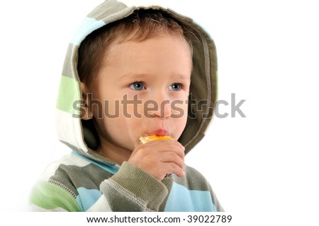 little boy eating orange