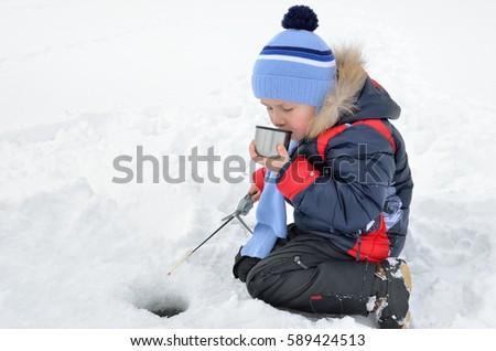 Little boy fishing on frozen river stock photo 589424471 for Frozen fishing pole