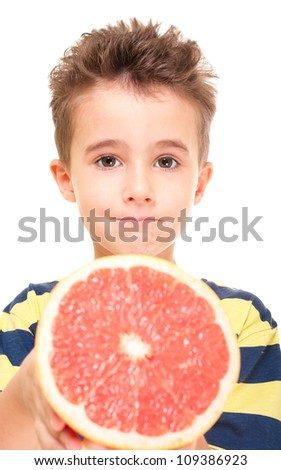 Little boy holding grapefruit isolated on white