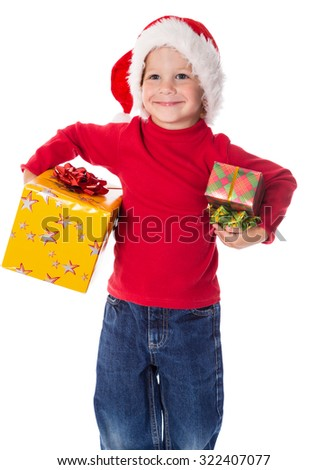 Little boy in christmas hat with two decorated gift boxes, isolated on white