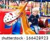 Little boy in the amusement park  - stock photo