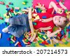 little boy is surrounded by many blocks  - stock photo