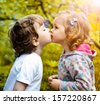 Little boy kissing a girl - stock photo