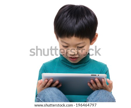 Little boy look at tablet