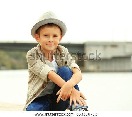 Little boy on the riverside
