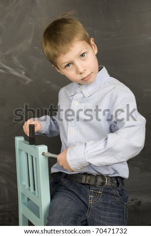 little boy playing in class room
