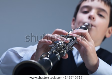 Little boy playing on the clarinet
