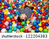 Little boy playing with balls - stock photo