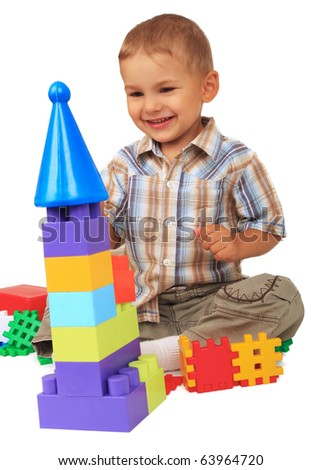 Little boy playing with blocks on  white background