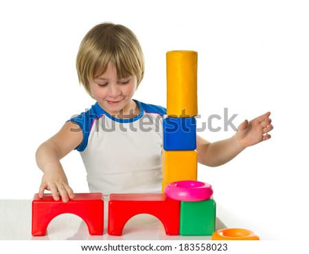 Little boy plays with a plastic bricks