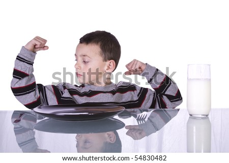 Little Boy Showing His Muscles at the Breakfast Table