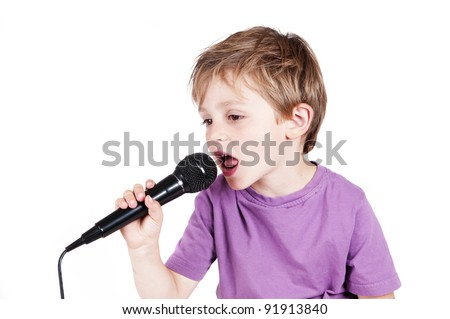 Little boy singing with a white background