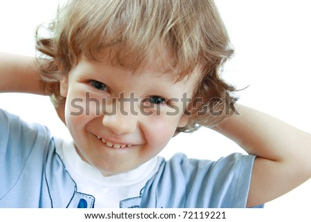 Little boy smiling and holding hands head. White background