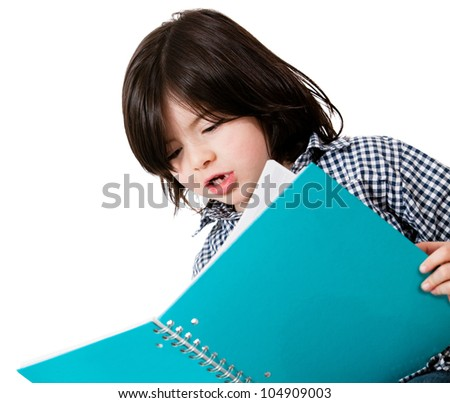 Little boy studying with a notebook - isolated over a white background