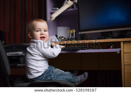 little boy using computer