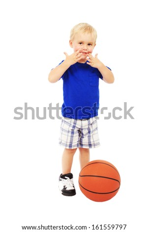 Little boy with a ball, isolated on white