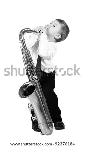 little boy with a saxophone