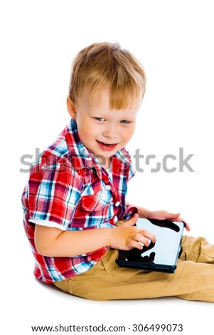 Little boy with a Tablet PC sitting on the floor