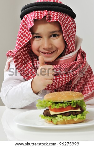 Little boy with burger