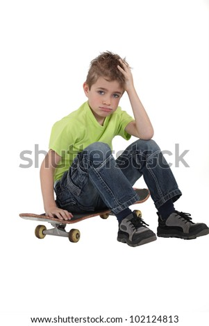 Little boy with skate board