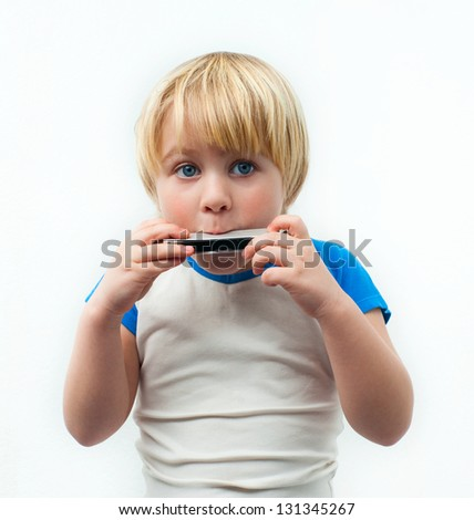Little boy with the harmonica