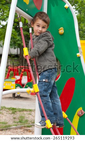 Little boy 3 years old playing at playground