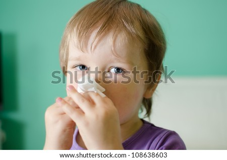 Little child - boy during cleaning his nose