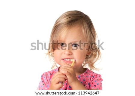 Little child brushes her teeth, isolated over white