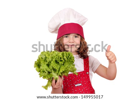 little cook with fresh green salad and thumb up