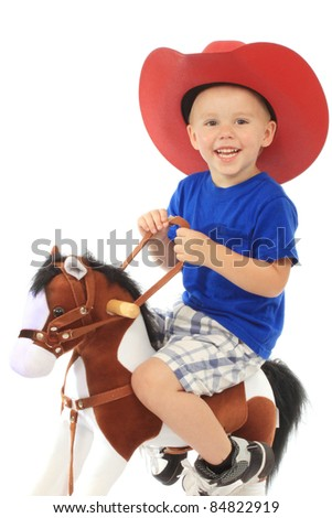 Little cowboy in a large red hat