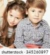 little cute boy and girl hugging playing on white background, happy family smiling fashion - stock photo