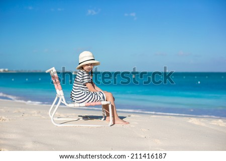 Little cute girl in hat at beach during caribbean vacation