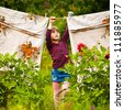 Little five-year girl with clothespin outdoor - stock photo