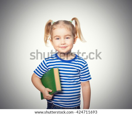 Little Funny girl in striped shirt with books. Isolated on gray background
