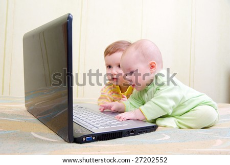 Little girl and boy using laptops.Computer generation