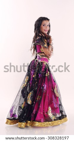 Little girl bellydancer in pink and black costume portrait