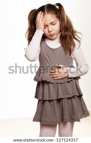 little girl has a headache on white background